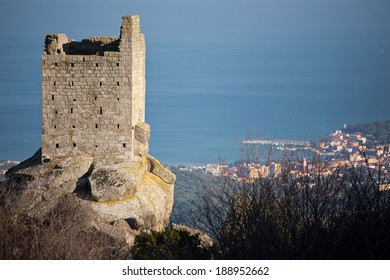 remains of an old tower on the island of Elba, with a sea view