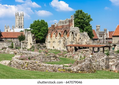 The remains of the oldest Benedictine monastery St Augustines Abbey in Canterbury, Kent, UK. The tower of Canterbury Cathedral can be seen in the distance.