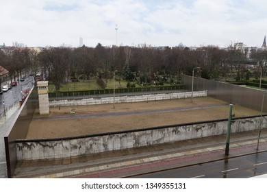 Remains of the original Berlin Wall and watchtower at the Berlin Wall Memorial (Berliner Mauer) on Bernauer Straße in Berlin, Germany, viewed from above.