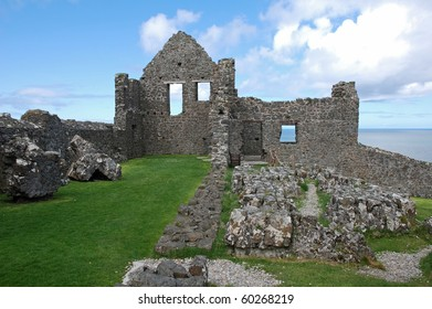 Remains of the past, ruins of Dunluce Castle on the cliffs of the Antrim coast in Northern Ireland