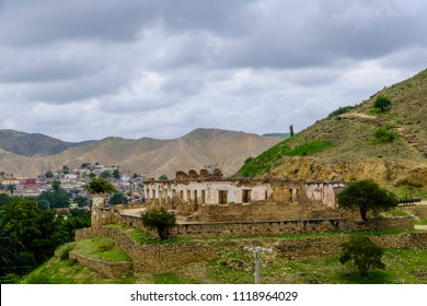 Remains of Portugese fort on hillside with city of Lobito Angola and hills in background