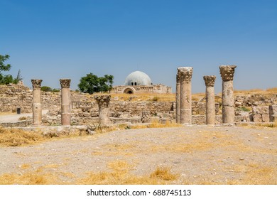 Remains of Roman buildings with background of Umayyad Palace in the Amman Citadel, known in Arabic as Jabal al-Qal'a, a historical site at the center of downtown Amman, Jordan.