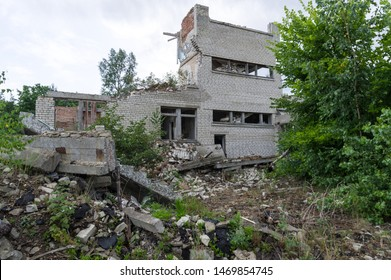 The remains of the ruins of a secondary school. The remains of the building. The ruins of a children's school.