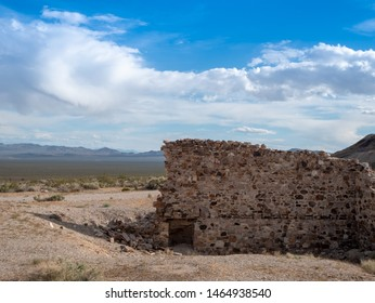 Remains of a stone wall in ruins of a building in the desert ghost town of Rhyolite, Nevada