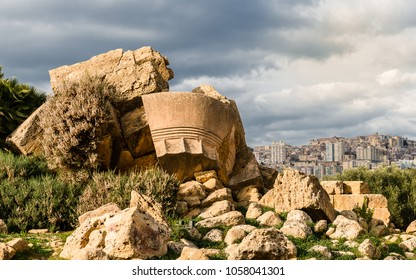 Remains of the Temple of Olympian Zeus in the Valley of the Temples, in Acragas, an ancient Greek city in Sicily, Italy. The modern city of Agrigento is on the right.