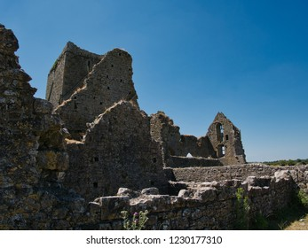 Remains of the wall of the Hore Abbey ruin in Cashel with blue sky in the background