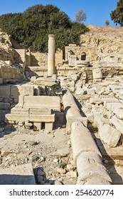 Remains of water pipes, columns and buildings in the ruins of an ancient city in Cyprus