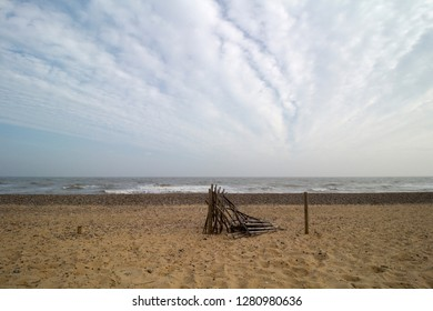 Remains of a wood and wire fence on Walberswick Beach, Suffolk, England
