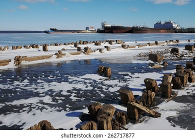 remains of a wooden pier and ships in port in Petrozavodsk, Russia