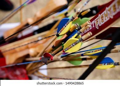 Remaja berhijab memanah or A muslimah teenager practicing archery concentration target bullseye