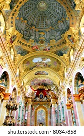 The remarkable trompe l'oeil dome of the Jesuit Church (Jesuitenkirche), a two-floor, double-tower church in Vienna, Austria, influenced by early Baroque principles but remodeled in 1703-1705.