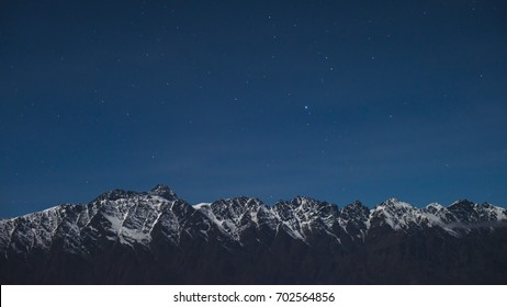 The Remarkables at seen from the Skyline Gondola in Queenstown, New Zealand at late dusk.