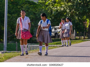 REMATE, GUATEMALA - AUGUST 12, 2008: Girls walking to school in the morning.