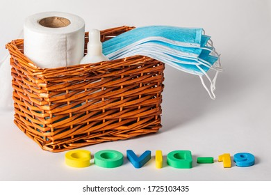 Remedies for coronavirus infection covid-19 in a wicker basket on a white background. Antiseptic, medical masks and napkins.
