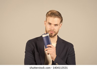 Remedies get rid of dandruff. Man formal suit hold bottle shampoo grey background. Itchy scalp and flakiness skin. Shampoo solve dandruff problem. Dandruff common male problem. Anti dandruff shampoo.