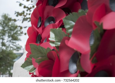 Remembrance day. Close up of poppies in front of British monument