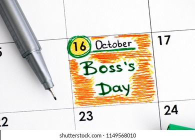 Reminder Boss`s Day in calendar with green pen. Close-up.