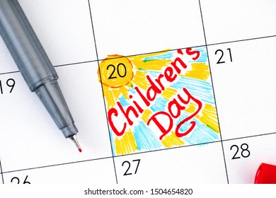 Reminder Childrens Day in calendar with red pen. November 20.