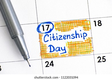 Reminder Citizenship Day in calendar with pen. Close-up.