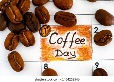 Reminder Coffee Day in calendar with some coffee beans. Close-up.