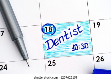 Reminder Dentist 10-30 in calendar with blue pen.
