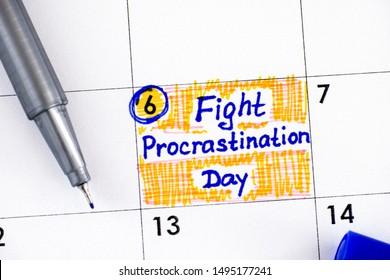 Reminder Fight Procrastination Day in calendar with blue pen. September 06.