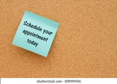 A reminder to make an appointment, Bulletin board with a blue sticky note with text Schedule your appointment today