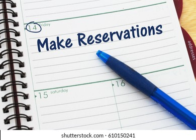Reminder to make reservations, A day planner with blue pen with text Make reservations