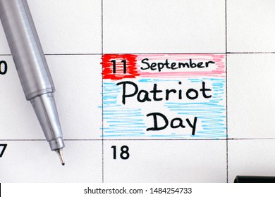 Reminder Patriot Day in calendar with black pen. September 11. Close-up.