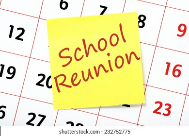 Reminder of a School Reunion written on a yellow sticky note and attached to a wall calendar