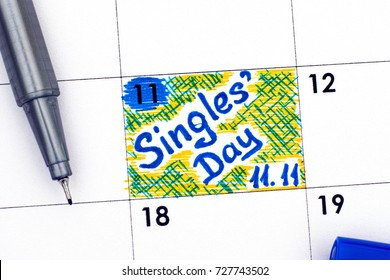 Reminder Singles Day 11.11 in calendar with blue pen. Close-up.