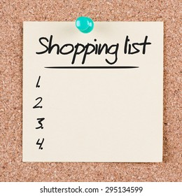 Reminder sticky note on cork board with SHOPPING LIST text