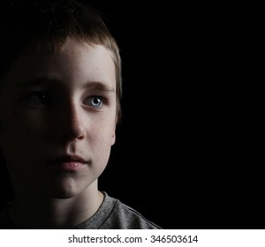 reminiscent portrait of a young boy