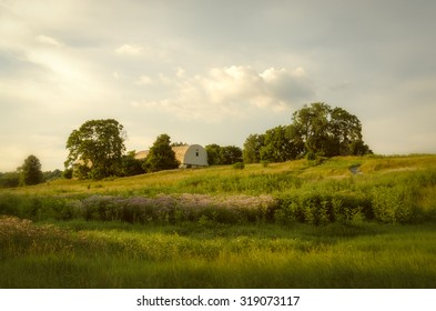 Remnant of Better Days is a landscape photograph of the once thriving Three Little Bakers Golf Course in Pike Creek Delaware that is now over grown with weeds and grasses.