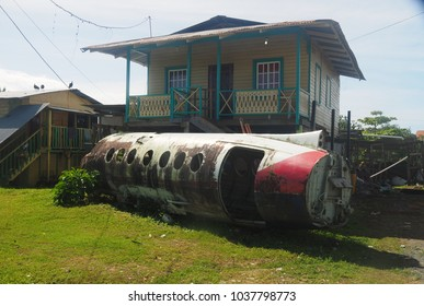 Remnants of an aircraft that made its last landing at the Bocas del Toro airport .... perhaps touching down a little too hard.  It has been there since 2006.  In now is a backyard ornament.