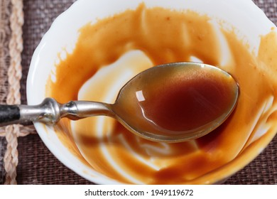 Remnants of salted caramel on the sides of the bowl. Close-up.