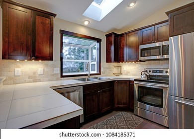 Remodeled Kitchen With Skylights And Vaulted Ceiling.