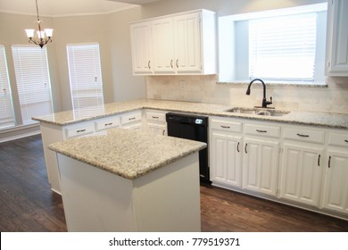 Remodeled Kitchen with White Granite Countertops