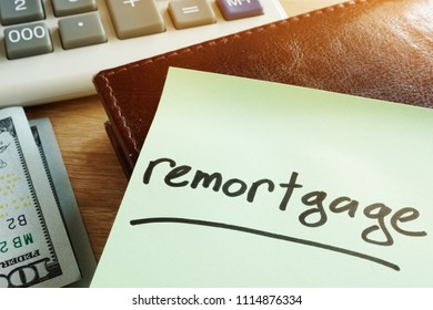 Remortgage concept. Memo stick, calculator and money.