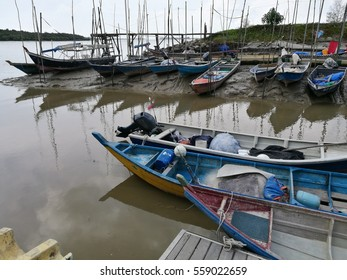 Remote area of fishermen village on island of west Malaysia. Including in the photo are boats, jetty, dining shop, net and fishing equipment during lowtide dated 01/16/2017