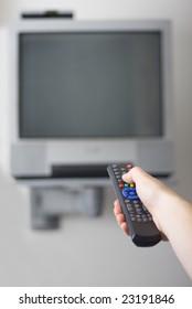 remote control against TV set
