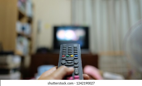 Remote control with blur finger and room background