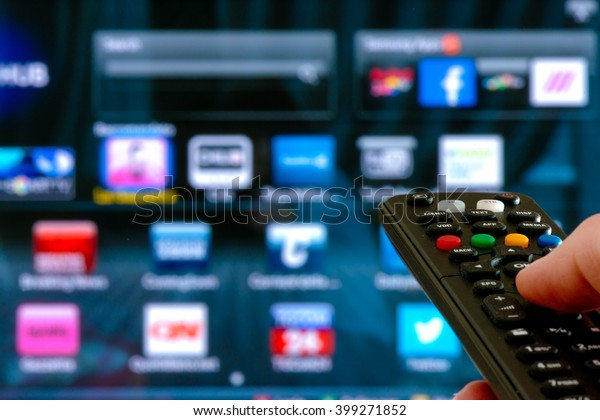 remote control interacting with smart television