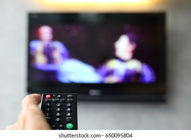 Remote control pointing to Liquid crystal display television (LCD TV), Selective focus on remote control button