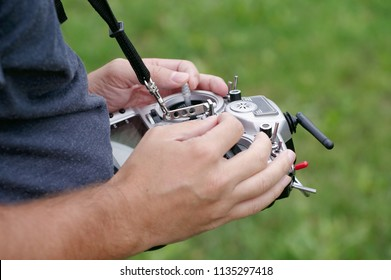 Remote control for quadrocopter or racing drone in male hands, close-up view