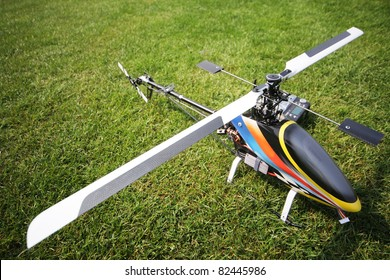 remote controlled helicopter against grass