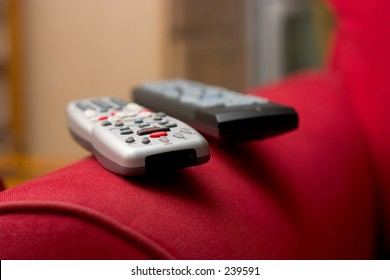 Remote controls on the arm of the couch