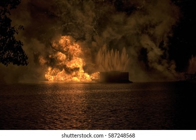 Remote Fireworks barge explosion on a lake during a holiday celebration