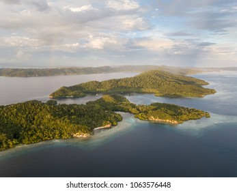 The remote islands of Raja Ampat are surrounded by calm seas and healthy reefs. This tropical region is known as the heart of the Coral Triangle due to its marine biodiversity.