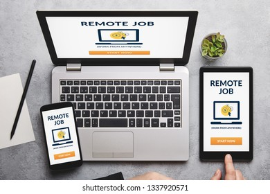 Remote job concept on laptop, tablet and smartphone screen over gray table. Flat lay